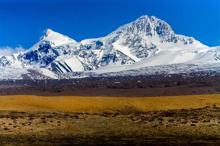 Tibetan landscape and Gang Benchnen North 7416 m, Tibet, China.