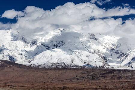 Maztag Ata Mountain. Landscape around Karakul Lake, Xinjiang, China. (Kirghiz: black lake) Stock Photo