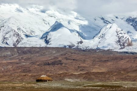 Kyrgyz yurt in the landscape around Karakul Lake (lake is 3,600 meters above sea level, at the foot of the Maztagata Mountain) Xinjang, China.