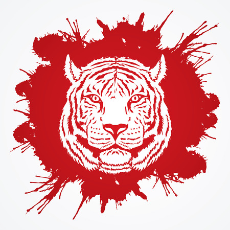 Tiger head designed on splatter blood graphic vector.