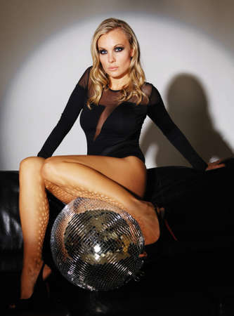 Studio portrait of young beautiful sexy woman with disco ball Stock Photo - 15381645