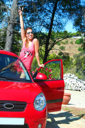 Red Car  Woman driver happy smiling coming out of car , enjoying her  summer holidays