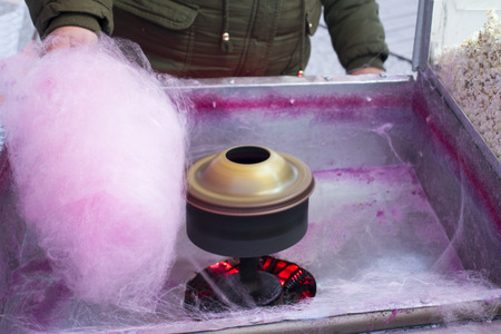 Process of Making sweet cotton candy. Street candy floss machine