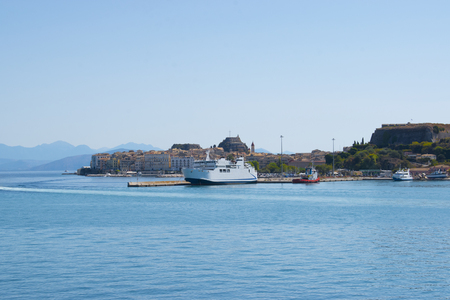 Panoramic view of Corfu island from water. Castle and old town