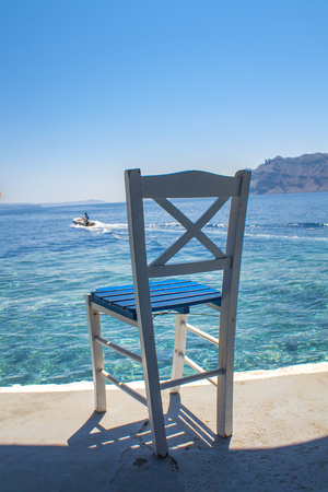 Traditional greek chear on the seaside. Travel concept of early booking