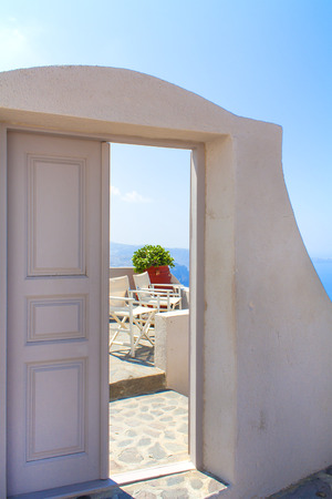 Doorway to a balcony overlooking the mediterranean sea. Thira, Santorini, Greece. Stock Photo