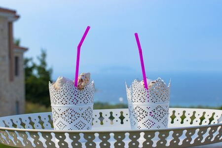 two summer fresh coctails with sea shells on summer background. Stock fotó