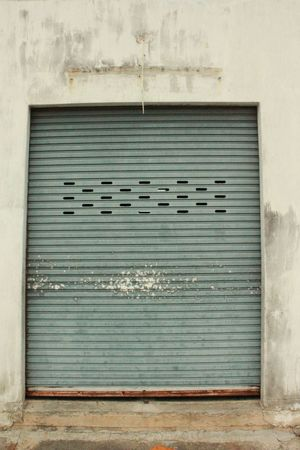 Old metal rolling door at old temple