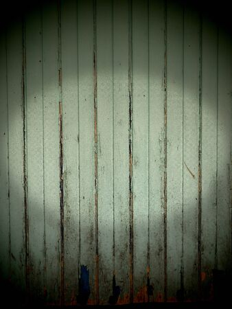 dreadful: Old wooden wall background Horror concept peeling of paint and lighting center for wording