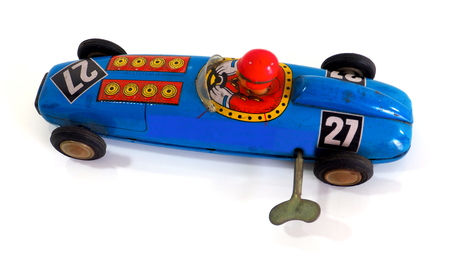 windup: Antique toy car top and side view and wind up with a reflection isolate