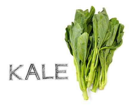 materia prima: Kale materia prima vegetal para el cocinero en blanco Silla de madera de la foto aislado en la cocina