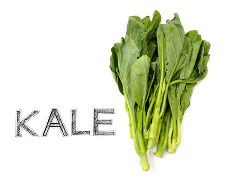 materia prima: Kale vegetable Raw material for cook on white wood chair photo isolate in kitchen Foto de archivo