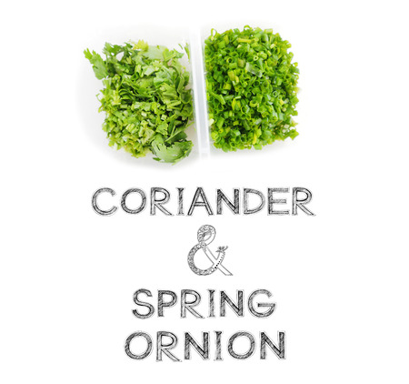 raw material: Coriander and spring onion in plastic box and partition raw material for cook Stock Photo