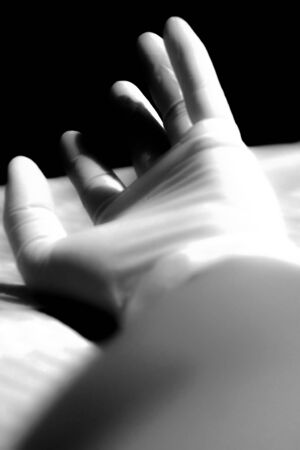 hand wear: My hand wear rubber glove in the night time, Concept feel bad and help me black and white color. Stock Photo