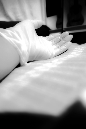 rubber glove: Photo Concept is Unconscious in the room help me please , This is my hand and wear the rubber glove sleep on the bed in the night time