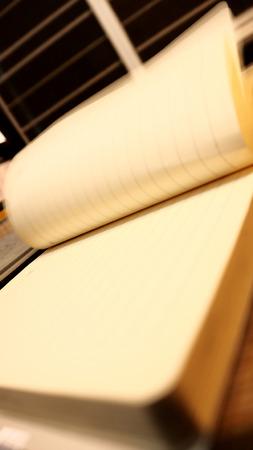 datebook: Note Book Open is near window photo moving blur is near the window.