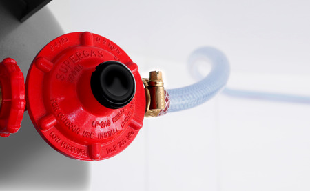 Regulator gas with rubber tube fade off blur and Gas valves and Valve top view and white background.