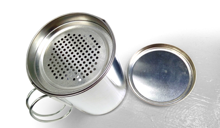 oil can: Oil Can Cup cook accessories have sieve food particles on top background Isolate white wood