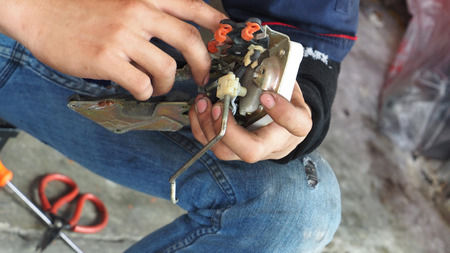 electric current: Repairman electric current Car lock in his hand