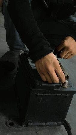 electric current: Asain Thai Technician mechanic hand check electric current car lock with battery power