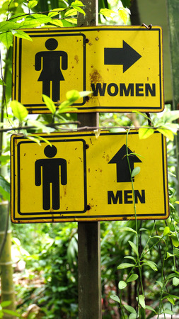 dowdy: Toilet woman and man retro sign symbol in garden house or park and resort