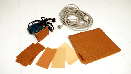 handy: Sander handy machine equipment have Coarse paper, Long plug trailers on white wood floor Stock Photo