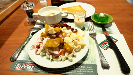 Salad, soup, cheese toast bread, jelly, mushroom soup, pudding on desk, Macro photo focus select at salad vegetable, In Sizzler Steak retaurant at Central west gate plaza branch Nonthaburi province Thailand, time 05:57 pm. 2017 June 4.