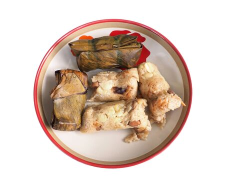 original plate: Sticky rice dumpling is Chainese food, This my mother idea to The original wrapped material was dried bamboo leaves, but in the picture is the banana leaves, Isolate and clipping paths
