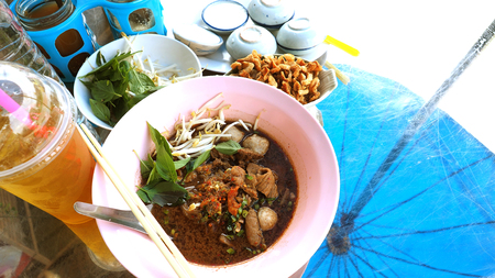 Boat noodles pork Thai food has meatballs, The soup also contains nam tok are commonly served with pork crackling and basil or sweet basil, has chrysanthemum tea ice and Steamed Pandanus Cake.