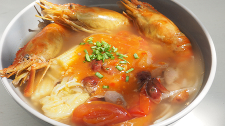 specific: Giant malaysian prawn pour the sauce chili sweet and sour diet and health menu idea on white wood has copy space, The ingredients are red grapes, onion, tomato, baby corn, Chinese cabbage, Enoki mushroom and pumpkin soup, Photo close up full frame.