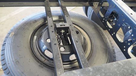 Tire spare part install on 6 wheel medium duty truck.