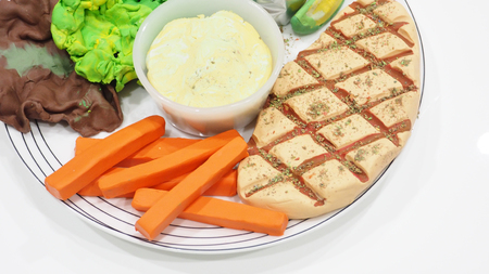 Mold clay or dough Pork grill steak activity of creative art are carrot, Salad cream, a baked potato with butter. Close up photo see the detail about how to do it. Reklamní fotografie