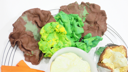 Mold clay or dough activity of creative art are lettuce, Salad cream, a baked potato with butter. This set in grill Pork steak, Close up photo see the detail about how to made it. Imagens