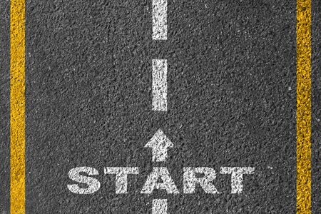 Start on the road. An inscription on asphalt. Stock Photo