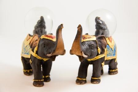 two elephants snow ball Thai souvenir on white backgroud Stock Photo