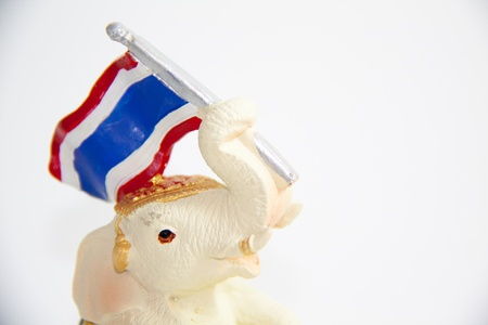 Elephant Waving flag of Thailand on white background - Thai gifts photo
