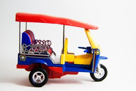 tuktuk: Tuktuk taxi model Thailand three colors on white background - Thai souvenirs