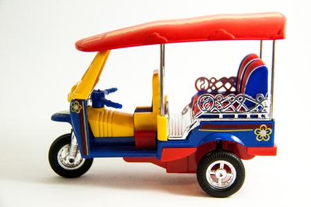 tuktuk: Tuk-tuk taxi model Thailand red blue yellow colors on white background - Thai souvenir