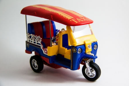 tuktuk: Thailand tuktuk taxi model red blue yellow colors on white background - Thai souvenirs