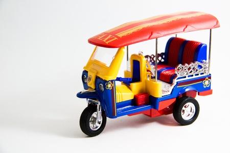 tuktuk: Taxi Thailand tuktuk model red blue yellow colors on white background - Thai souvenirs