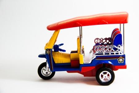 tuktuk: Taxi Thailand tuk-tuk model red blue yellow colors on white background - Thai souvenirs
