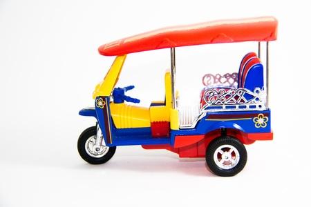 tuktuk: Taxi Thailand tuk-tuk model three colors on white background - Thai Gifts Stock Photo