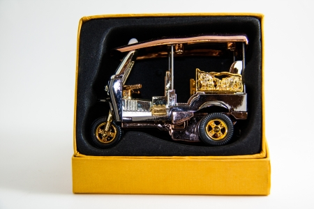 Tuktuk Model Taxi Thailand gold and copper color in yellow case on white background - Thai souvenirs photo