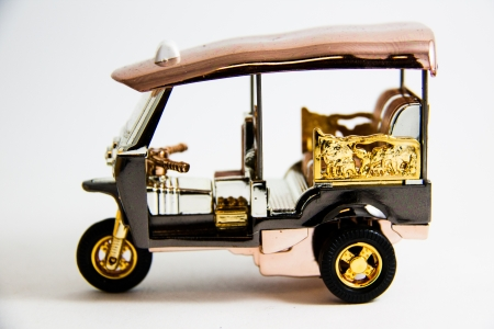 memento: Tuktuk Model Taxi Thailand gold and copper color on white background