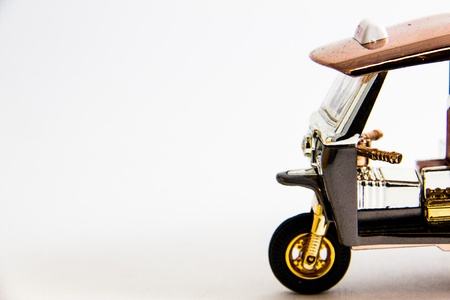 Tuktuk Model Taxi Thailand gold and copper color on white background