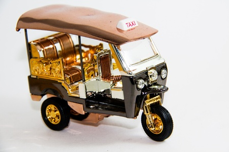 Model Tuktuk Taxi Thailand gold and copper color on white backgroud - Thai souvenirs