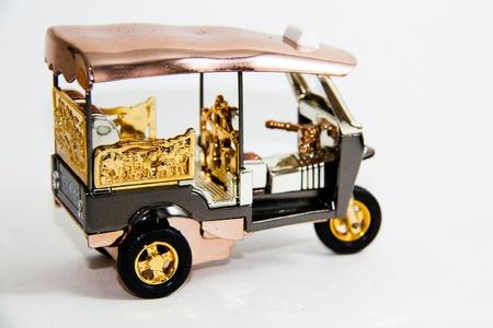 Modell Tuktuk Taxi Thailand auf wei�em backgroud - Thai Souvenir Lizenzfreie Bilder