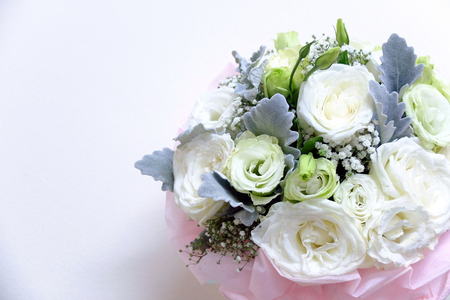 Beautiful wedding bouquet of green and white roses