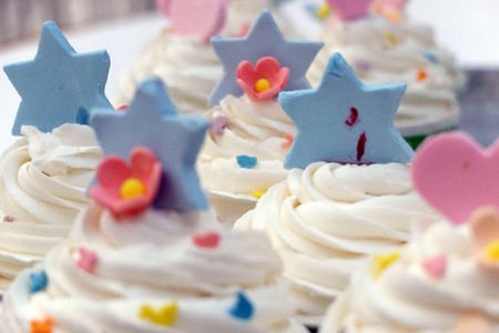 Delicious White cupcakes decorated with Blue Star