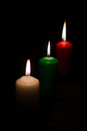 3 candles with colorful bokeh in the dark background 3 candles with dark space in the black background Stock Photo - 15018399
